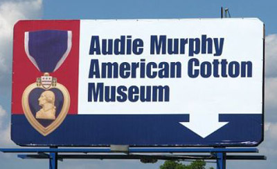 Billboard facing Interstate 30 indicating location of the Audie Murphy/American Cotton Museum.