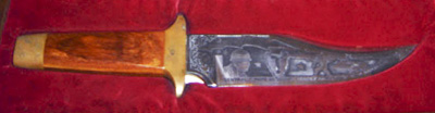 An engraved Audie Murphy collectors knife.