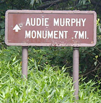 Audie Murphy Memorial sign at main gate and parking lot. Photo provided by Fred Davis.