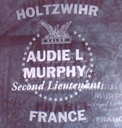 Etched glass panel of Audie Murphy at the Congressional Medal of Honor Memorial, Indianapolis, Indiana. Photo source: Kenneth Leff.