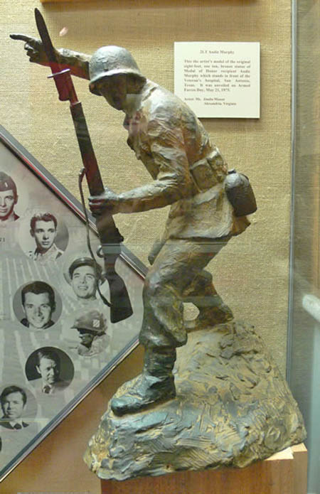 National Infantry Museum display of a small bronze scale replica statue. The original statue is found in front of the Audie Murphy Veterans Memorial Hospital, San Antonio Texas.
