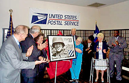 Left to right are Congressman Sam Johnson, Senator Phil Grahmm, Nadine Murphy, Congressman Ralph Hall, Billie Murphy Tindol, Congresswoman Eddie Bernice Johnston, Diane Thomason, and USPS representative Carl January as the Audie Murphy commemorative stamp is unveiled in Dallas, Texas on October 24, 1999. Photo by Richard Rodgers.